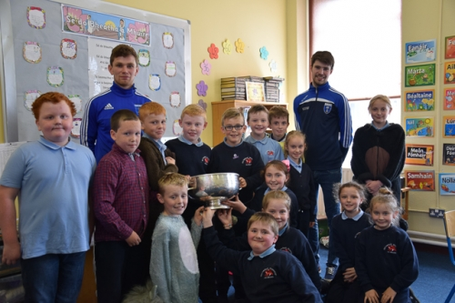 Scotstown GFC players and the Mick Duffy Cup visit Ms Kildea's 3rd/4th Class