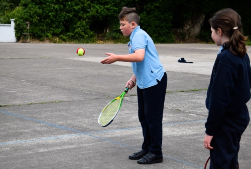 Nathan,5th Class learning some tennis techniques