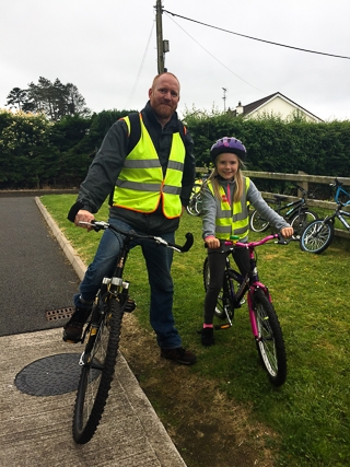 Taegan with her father, Andrew, who cycled from Ballinode to Scotstown